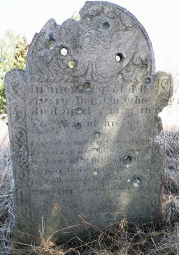 Shot up gravestone