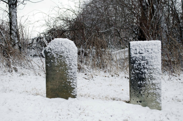 snow on gravestones