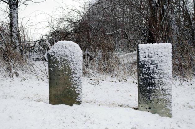 snow on gravestones